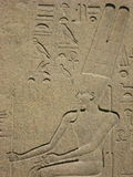 Relief at the Egyptian Museum in Cairo. Egyptology, Bas relief at the Egyptian Museum in Cairo depicting a pharaoh seated on his throne stock photo