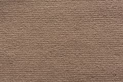 Relief fabric texture in soft brown colour. High resolution photo Royalty Free Stock Images