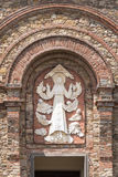Relief on the facade of the church. Of the Ascension of Virgin Mary in Panzano in Chianti, Italy Royalty Free Stock Photography