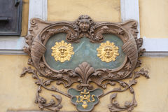Relief on facade of old building,two suns, Nerudova street,  Prague, Czech Republic. Europe. Townhouses in  Prague are often decorated with charming Royalty Free Stock Photo