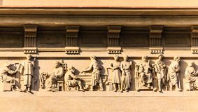 Relief of Figures on Building Details Stock Photos