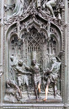 Relief on front door of the Cathedral in Milan Stock Image