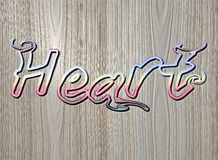 Relief HEART text on wooden background Royalty Free Stock Images