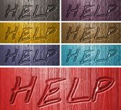 Relief HELP words on wooden background Stock Photo