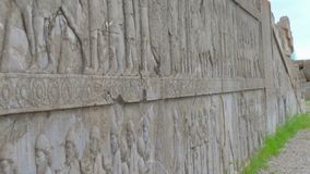 Relief images on the walls in Tachara palace. In Persepolis stock video
