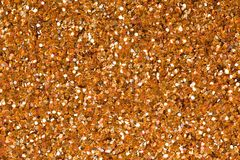 Relief light brown texture and glitter. Can be used as background. stock images