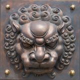 Relief, lion head. Asia China, Tianjin, Lion Forest bridge relief, decorative lion head Royalty Free Stock Image