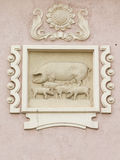Relief with pigs Stock Images