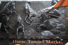 Relief of running horses at Stables Market. A large relief of running horses at market arc. Stables Market, Camden Town, London, Great Britain Royalty Free Stock Image