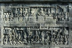 Borobudur Relief Sculptures. Relief sculptures in Borobudur temple which tells about the life of society in ancient times royalty free stock photos
