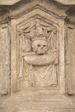 Relief with a skull. On a statue in historical centre of town Kutna Hora in the Czech republic Royalty Free Stock Photos