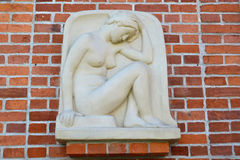 Relief The squating girl' (Genius), a close up. Kaliningrad Royalty Free Stock Image