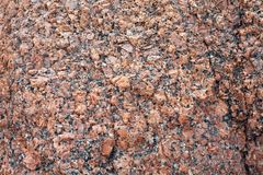 Relief surface of a granite stone with natural texture Stock Photography