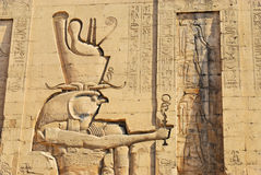 Relief at the Temple of Edfu in Egypt. Horus is one of the oldest and most significant deities in ancient Egyptian religion, who was worshipped from at least the Royalty Free Stock Image
