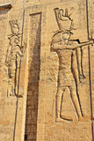 Relief at the Temple of Edfu in Egypt. Horus is one of the oldest and most significant deities in ancient Egyptian religion, who was worshipped from at least the Royalty Free Stock Photography
