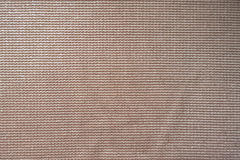 Relief texture of shiny beige fabric Stock Images