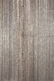 Relief texture of the surface of the old wooden board with poor processing, the expressive direction of the wood fibers. The relief texture of the surface of the Royalty Free Stock Photography