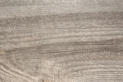 Relief texture of the surface of the old wooden board with poor processing, the expressive direction of the wood fibers Stock Photo