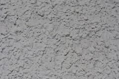 Relief volume plaster on the wall of the building, light gray. stock photo