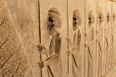 Symbolic relief on a wall of the ancient city of Persepolis Royalty Free Stock Photography