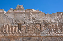 Relief of winged sun symbol of Zoroastrianism in ruined Persepolis Royalty Free Stock Photo