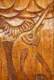 Relief wood carving of a fish Royalty Free Stock Image