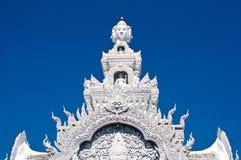 Reliefe de los bas de dios en templo tailandés Fotografía de archivo