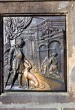 Reliefs on the bronze plaque at the statue of St John Nepomucen, Charles Bridge in Prague Royalty Free Stock Photos