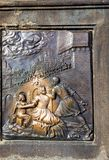 Reliefs on the bronze plaque at the statue of St John Nepomucen, Charles Bridge in Prague Royalty Free Stock Photo