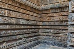 Reliefs on the outer wall of the Hoysaleswara Temple, Hoysala style, Halebidu, Karnataka. stock photography