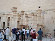 Reliefs on the walls. Egypt. Ruins of Egypt. Ancient columns. Tourists stock photography