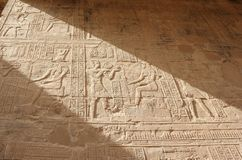 Reliefs on the walls of the Temple of Edfu. Egypt. Stock Image