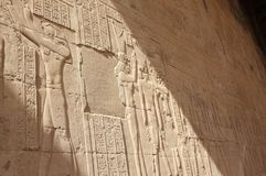 Reliefs on the walls of the Temple of Edfu. Egypt. Royalty Free Stock Photos