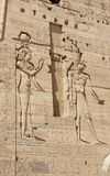 Reliefs on the walls of the Temple of Philae. Egypt. Philae is an island in Lake Nasser, Egypt. It was formerly an island in the First Cataract of the Nile Stock Images
