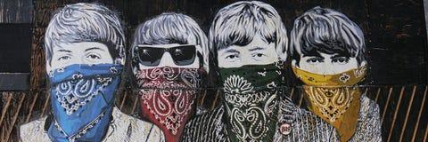 Relieves del artista de la calle de Sr. Brainwash en Londres Reino Unido imagen de archivo