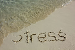 Relieving Stress. Word stress one the beach Royalty Free Stock Photos