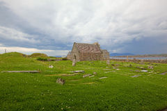 Relig Odhrain and St Oran's Chapel Isle of Iona. Scenic view of the ancient cemetery, Relig Odhrain, final resting place of numerous kings and queens as well as Royalty Free Stock Photo