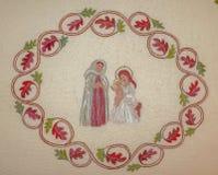Religiös broderi Julplats med Anna, Mary och Jesus Arkivbild