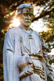 Religiös staty med signalljuset Royaltyfri Foto