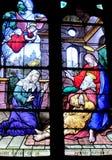 Religiöses Bild auf Buntglas in der Kirche Stockbilder