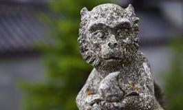 Religijna kamienna statua małpa fotografia stock