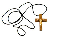 Religion. Wooden cross with a rope on a white background Stock Photography