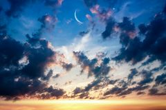Religion background .  Generous Ramadan  . Crescent moon with beautiful sunset background . Generous Ramadan . Light from sky . Religion background royalty free stock images