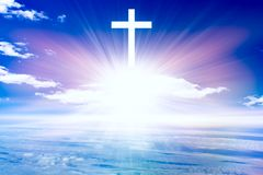 Religion background .  Paradise heaven . Light in sky . Heavenly Cross . Religion symbol shape .  Dramatic nature background  . Glowing cross in sky . Happy royalty free stock photography