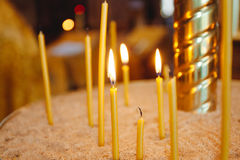 Religion. Burning candles in a church Royalty Free Stock Photos