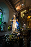 Religion, catholic, cebu cathedral statue Sta. Nino. The famous statue of Sta. Nino dressed in blue standing amidst flowers in the cathederal of Santa Nino Cebu Royalty Free Stock Images