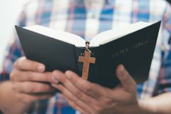 Religion Christianity concept background. Religion Christianity concept. Man holding and reading the holy Christian Bible stock image