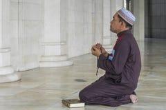 Religion concept. Asian muslim man praying Stock Photo