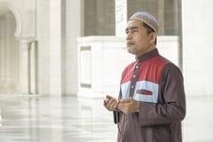 Religion concept. Asian muslim man praying Royalty Free Stock Image