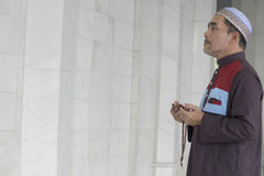 Religion concept. Asian muslim man praying Royalty Free Stock Photo
